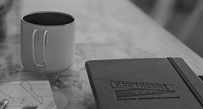 calendar in notebook and coffee cup